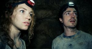 """This image released by Universal Pictures shows Perdita Weeks, left, and Ben Feldman in a scene from the film, """"As Above, So Below."""" (AP Photo/Universal Pictures) ** Usable by LA, DC, CGT and CCT Only **"""